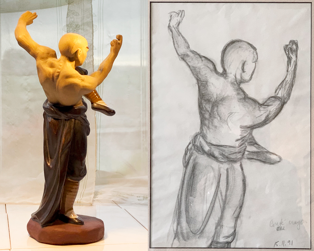 A small figurine of a fighting Shaolin monk