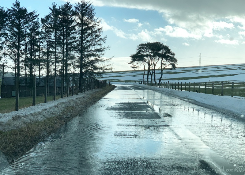 snow and meltwater on the roads